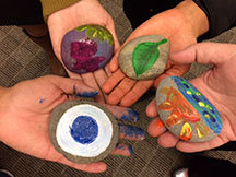 Graduate Students Rock Paintings at CARE Event